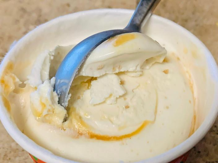 Trader Joe's peach crisp ice cream getting scooped out of the carton