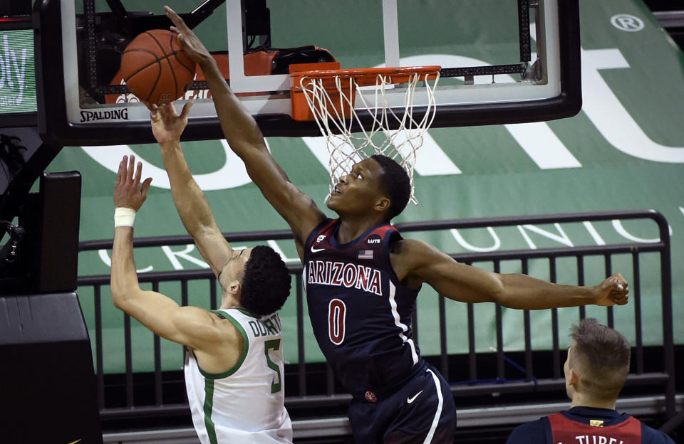 Arizona guard Bennedict Mathurin (0) blocks the shot of Oregon guard Chris Duarte (5) during the first half of an NCAA college basketball game Monday, March 1, 2021, in Eugene, Ore. (AP Photo/Andy Nelson)