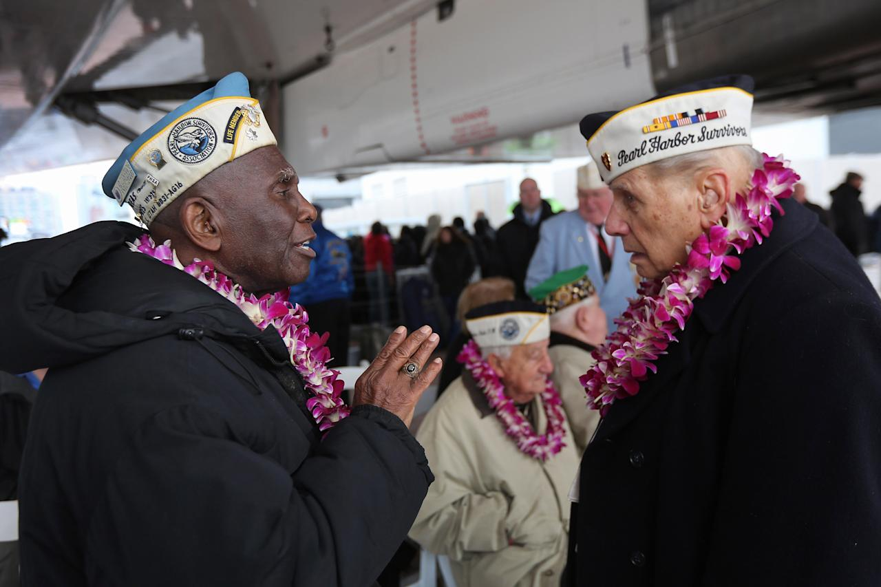 Pearl Harbor survivors Clark Simmons, 91, (L), and Aaron Chabin, 89, attend a ceremony commemorating the 71st anniversary of the Japanese attacks on Pearl Harbor on December 7, 2012 in New York City. World War II veterans from the New York metropolitan area participated in a wreath-laying ceremony next to the Intrepid Sea, Air and Space Museum, which was damaged in Hurricane Sandy and is undergoing repairs.  (Photo by John Moore/Getty Images)