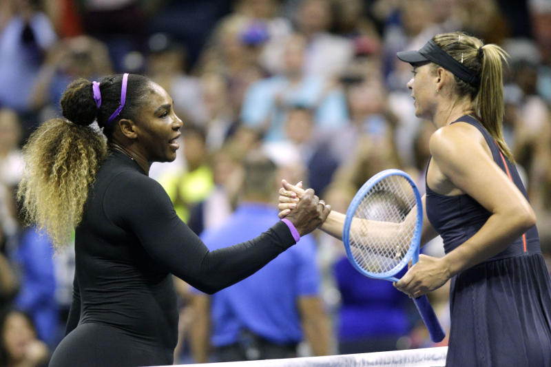 TOPSHOT - Maria Sharapova (R) of Russia shake hands after losing against Serena Williams of the United Sates during their Round 1 women's Singles match at the 2019 US Open at the USTA Billie Jean King National Tennis Center in New York on August 26, 2019. (Photo by Kena Betancur / AFP) (Photo credit should read KENA BETANCUR/AFP via Getty Images)
