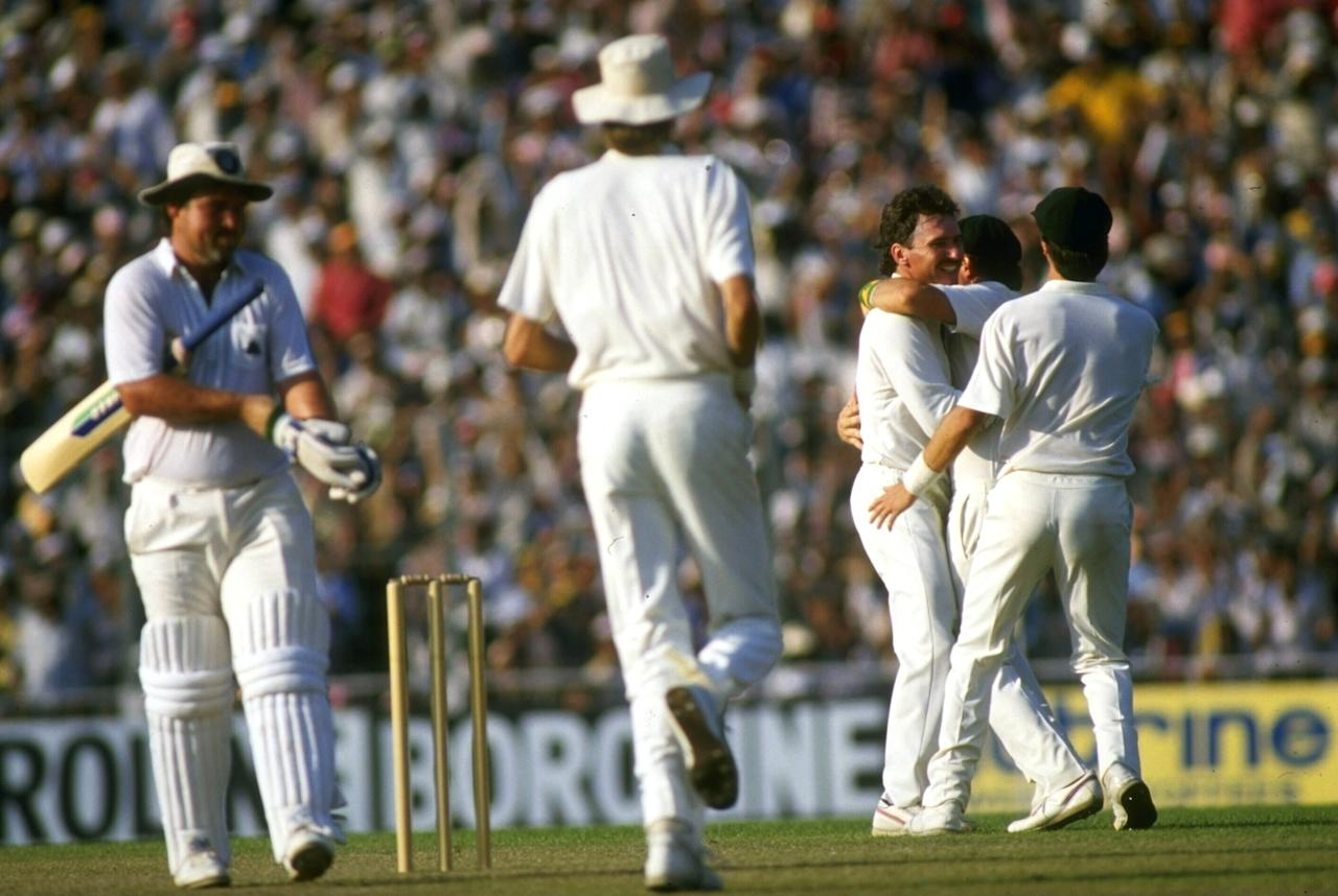 Nov 1987:  Allan Border of Australia is congratulated by team-mates after capturing the wicket of England captain Mike Gatting in the final of the World Cup in Calcutta.  Gatting had attempted a reverse sweep and got caught.
