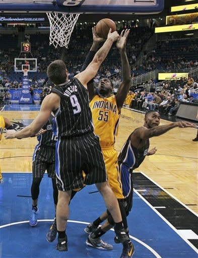 Indiana Pacers' Roy Hibbert (55) attempts a shot over Orlando Magic's Nikola Vucevic (9) during the first half of an NBA basketball game, Friday, March 8, 2013, in Orlando, Fla. (AP Photo/John Raoux)
