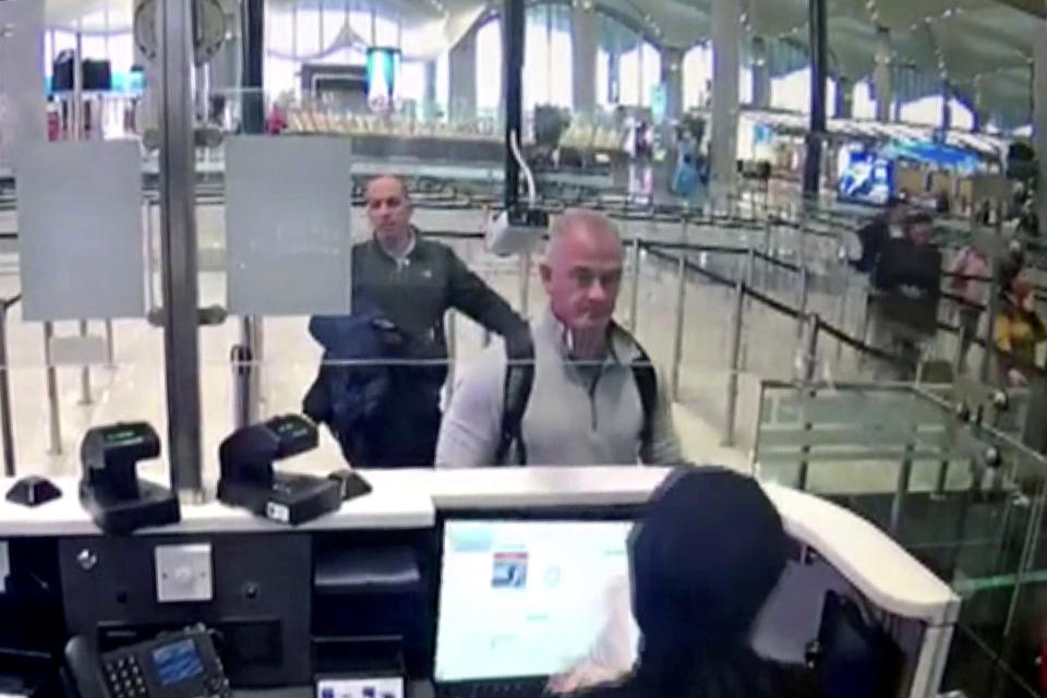 FILE - This Dec. 30, 2019, file image from security camera video shows Michael L. Taylor, center, and George-Antoine Zayek at passport control at Istanbul Airport in Turkey. Michael Taylor and his son Peter, suspected of helping former Nissan Chairman Carlos Ghosn skip bail and escape to Lebanon in December 2019 have been extradited to Japan. They were handed over to Japanese custody on Monday, March 1, 2021 and were due to arrive in Tokyo on Tuesday. (DHA via AP, File)