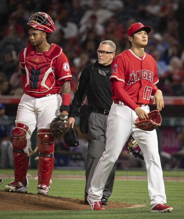 Los Angeles Angels starting pitcher Shohei Ohtani, right, leaves the baseball game against the Kansas City Royals during the fifth inning in Anaheim, Calif., Wednesday, June 6, 2018. (AP Photo/Kyusung Gong)