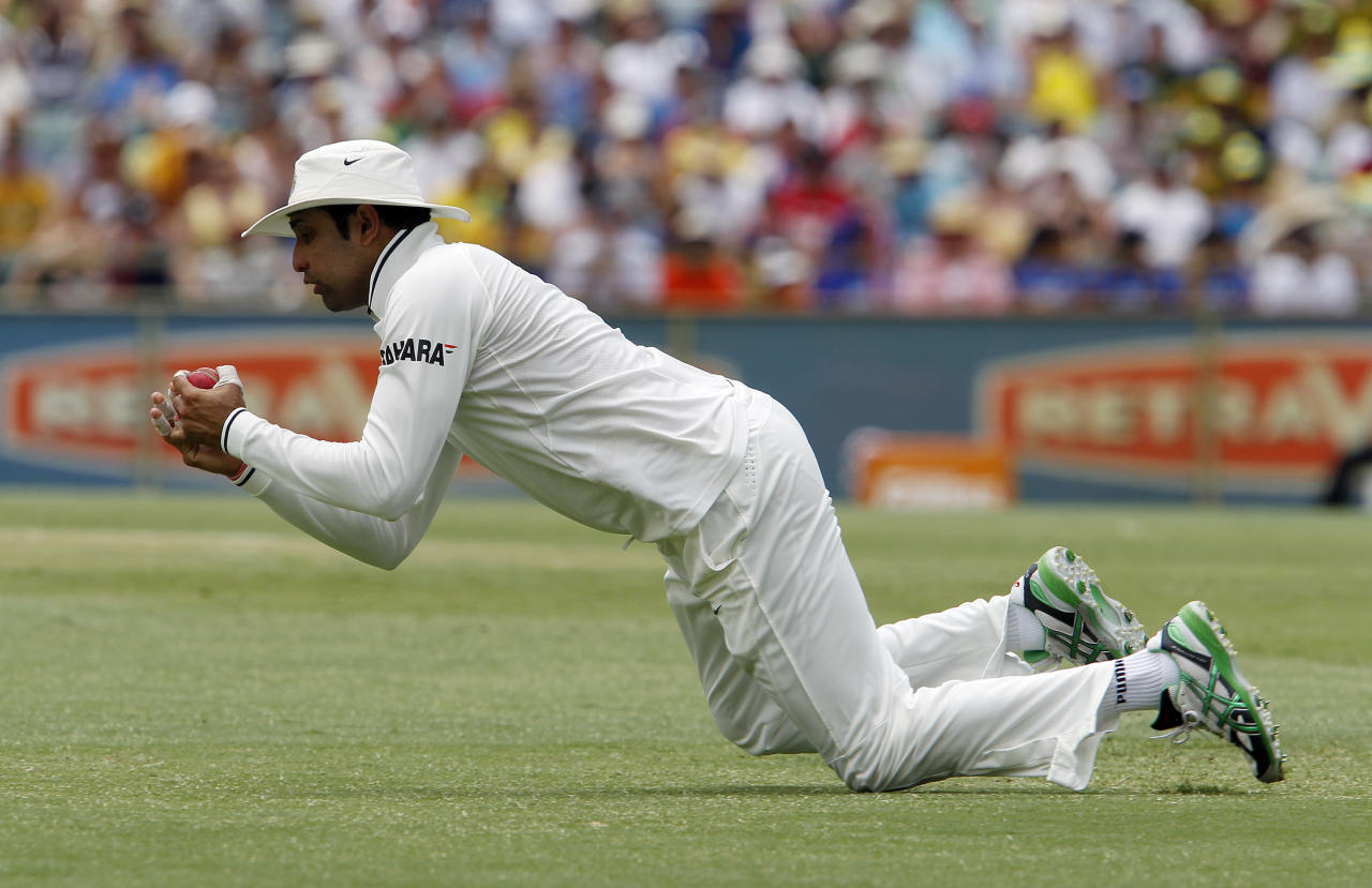 India's VVS Laxman catches Australia's Shaun Marsh on the second day of their cricket test match at the WACA in Perth, Australia, Saturday, Jan. 14, 2012. India made 161 in their first innings. (AP Photo/Theron Kirkman)