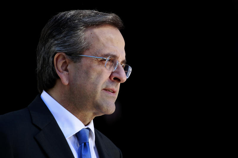Greek Prime Minister Antonis Samaras waits the arrival of  Lebanese President Michel Suleiman  in Athens, Thursday, Dec. 6, 2012. Greece's is finalizing a major tax reform bill, demanded by international rescue creditors as one of several conditions for continued payments. Greece's conservative-led government has promised to try and stem the country's punishing recession, but last month introduced another round of austerity measures. New unemployment figures, released Thursday, showed the country's jobless rate rising to 26 percent in September.  (AP Photo/Petros Giannakouris)