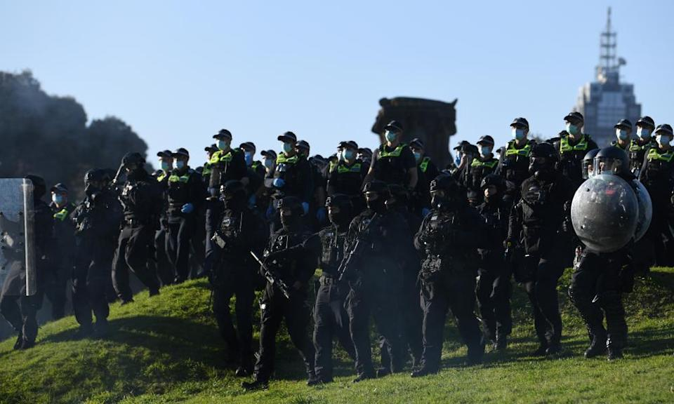 Riot police move protesters on at the Shrine of Remembrance on Wednesday.