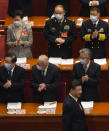 Hong Kong Chief Executive Carrie Lam, top left, and other elegates applaud as Chinese President Xi Jinping, bottom right arrives for the opening session of China's National People's Congress (NPC) at the Great Hall of the People in Beijing, Friday, March 5, 2021. (AP Photo/Andy Wong)