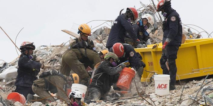 Search and Rescue teams look for possible survivors and to recover remains in the partially collapsed 12-story Champlain Towers South condo building on June 29, 2021 in Surfside, Florida.