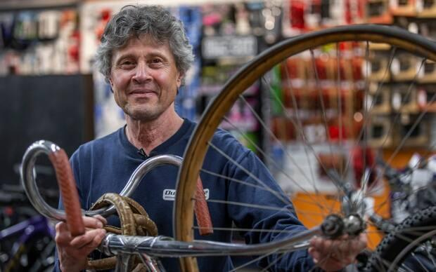 Fred Vandelinden works on a bike at Dutch Cycle in Regina, a family-owned business that has operated in the city since 1963. His nephew Freddie Vandelinden said he hopes the mechanics can keep up with demand and start taking in bikes again by March 24.