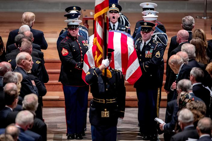 Members of the Honor Guard carry the flag-draped casket of former President George H.W. Bush out during his State Funeral at the National Cathedral, Wednesday, Dec. 5, 2018, in Washington. (Photo: Andrew Harnik/Pool via Reuters)