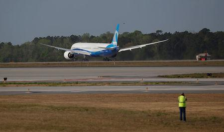 A photographer takes a photo during the first flight of the new Boeing 787-10 Dreamliner at the Charleston International Airport in North Charleston, South Carolina, United States March 31, 2017.  REUTERS/Randall Hill