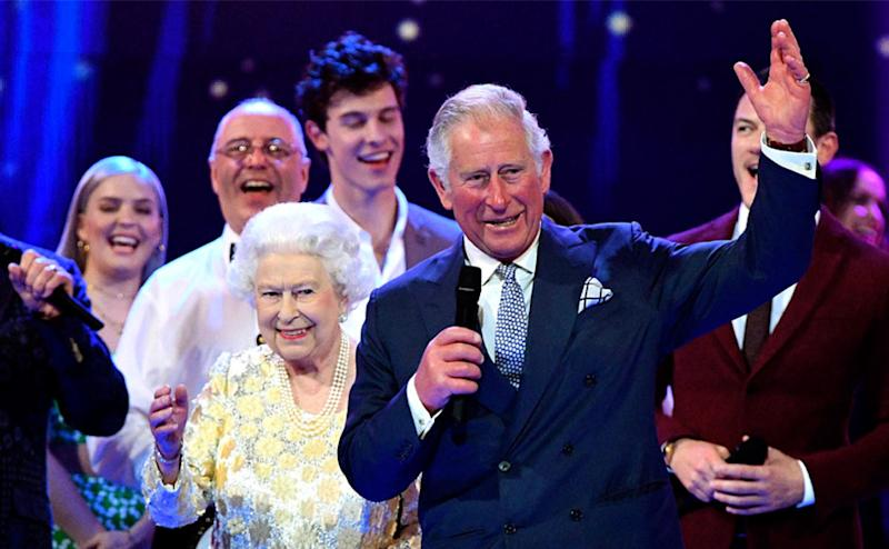 """Queen Elizabeth II, with her eldest son Prince Charles at her side, waved to the crowd as they celebrated her 92nd birthday in song. Charles got an enthusiastic response when he introduced her as: """"Your majesty, mummy."""" AP"""