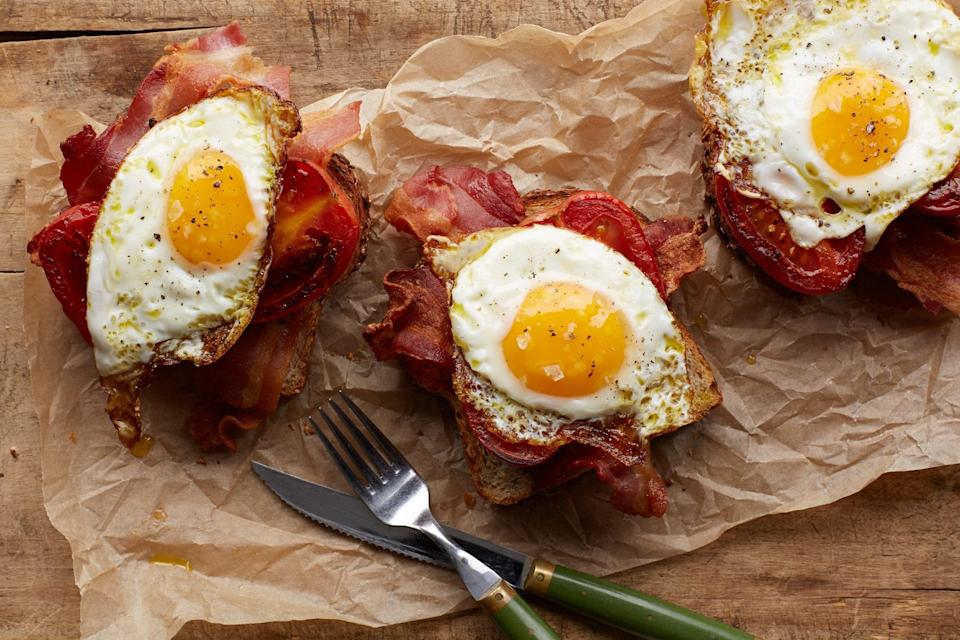 """Fry bacon, then cook tomatoes and eggs in the rendered bacon fat for a one-pan spin on the classic breakfast sandwich—bonus points if you toast the bread in bacon fat, too. <a href=""""https://www.epicurious.com/recipes/food/views/bacon-egg-and-tomato-toast-56389817?mbid=synd_yahoo_rss"""" rel=""""nofollow noopener"""" target=""""_blank"""" data-ylk=""""slk:See recipe."""" class=""""link rapid-noclick-resp"""">See recipe.</a>"""