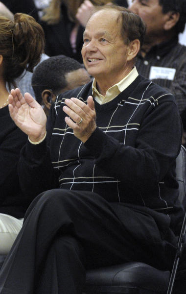 FILE - In this March 19, 2008, file photo, Minnesota Timberwolves owner Glen Taylor applauds his team during Minnesota's 98-94 win over the Memphis Grizzlies in an NBA basketball game in Minneapolis. Publisher Michael Klingensmith announced Tuesday, April 1, 2014, that Taylor has signed a letter of intent to buy the Minneapolis Star Tribune. (AP Photo/A.J. Olmscheid, File)