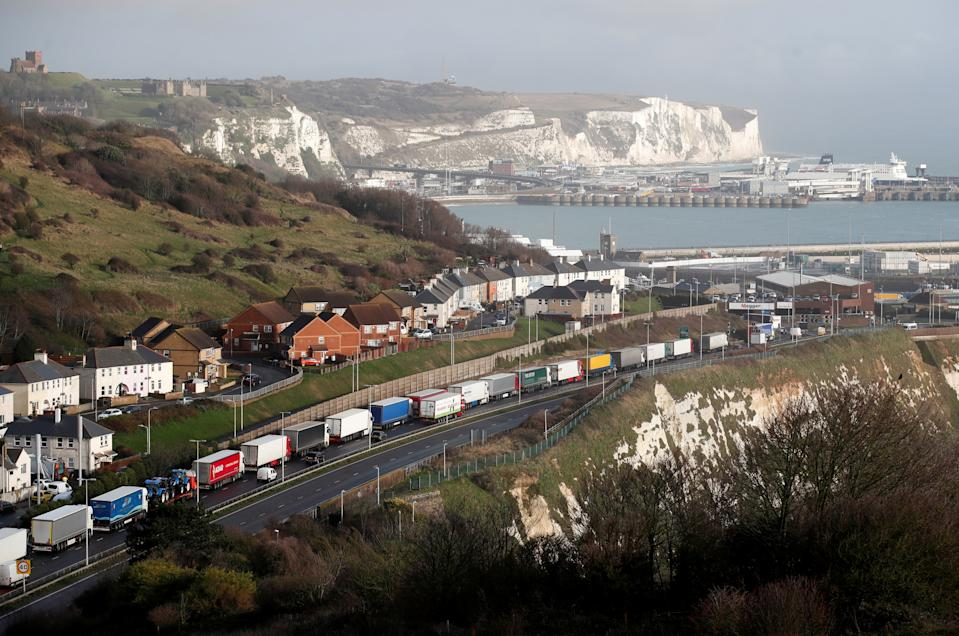 Lorries queue on the route into the port of Dover to board ferries to Europe, in Dover, Britain December 11, 2020. REUTERS/Peter Cziborra     TPX IMAGES OF THE DAY