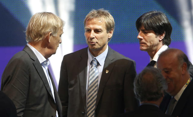 Cameroon head coach Volker Finke from Germany, United States head coach Juergen Klinsmann from Germany and Germany head coach Joachim Loew, from left, chat after the draw ceremony for the 2014 soccer World Cup in Costa do Sauipe near Salvador, Brazil, Friday, Dec. 6, 2013. (AP Photo/Silvia Izquierdo)
