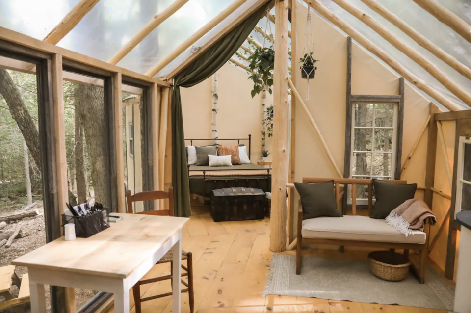 """<p><strong><a href=""""https://www.airbnb.com/rooms/43756543"""" rel=""""nofollow noopener"""" target=""""_blank"""" data-ylk=""""slk:Hemlock Hideout at Treehouse Camping:"""" class=""""link rapid-noclick-resp"""">Hemlock Hideout at Treehouse Camping: </a></strong><strong>Salisbury, New Hampshire</strong></p><p>Most treehouse rentals just look like a cabin that is built high in the trees, but this treehouse in New Hampshire looks like a real luxury treehouse, similar to the kind you would have played in as a kid. There is no electricity or running water, and very little cell service, with just an electric heater for warmth. The roof is greenhouse plastic, so you'll literally feel like you're sleeping outside and there's tons of natural light within the whole place. It's beautifully decorated and is in a lovely spot in the woods. </p>"""