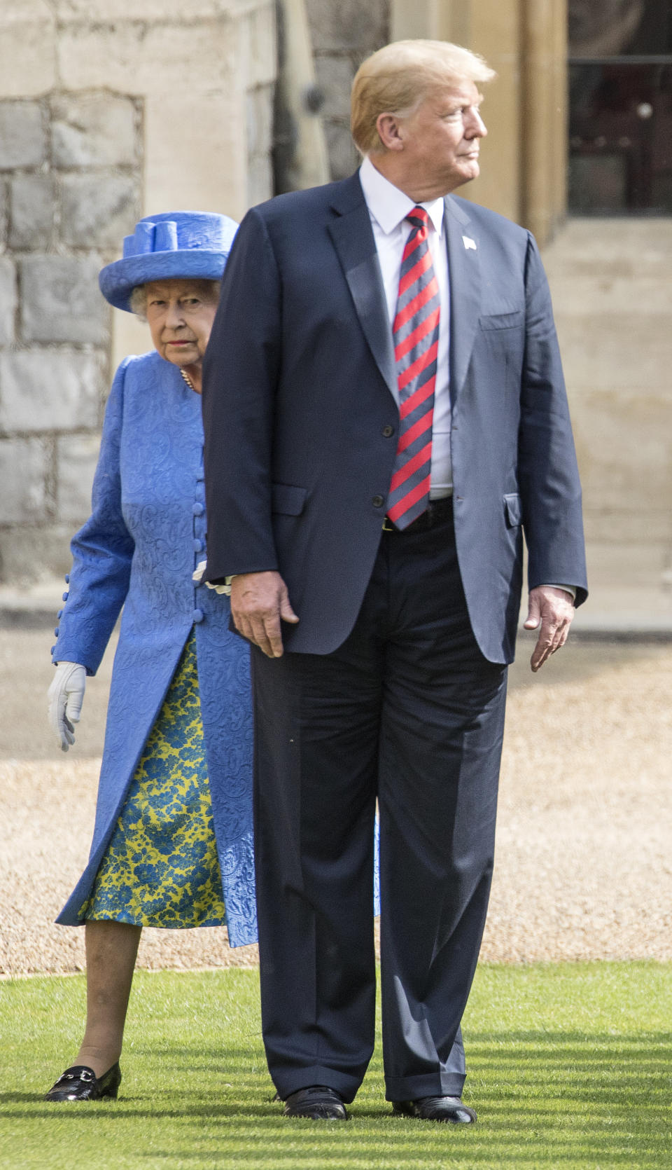 WINDSOR, ENGLAND - JULY 13:  U.S. President Donald Trump and Britain's Queen Elizabeth II inspect a Guard of Honour, formed of the Coldstream Guards at Windsor Castle on July 13, 2018 in Windsor, England.  Her Majesty welcomed the President and Mrs Trump at the dais in the Quadrangle of the Castle. A Guard of Honour, formed of the Coldstream Guards, gave a Royal Salute and the US National Anthem was played. The Queen and the President inspected the Guard of Honour before watching the military march past. The President and First Lady then joined Her Majesty for tea at the Castle.  (Photo by Richard Pohle  - WPA Pool/Getty Images)