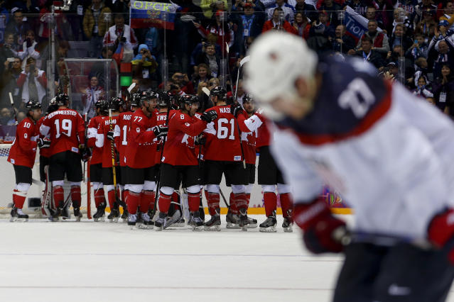 Team Canada celebrates after beating the USA 1-0 in a men's semifinal ice hockey game at the 2014 Winter Olympics, Friday, Feb. 21, 2014, in Sochi, Russia. (AP Photo/Petr David Josek)