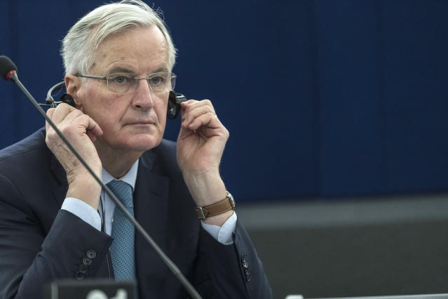 """European Union chief Brexit negotiator Michel Barnier listens during a debate on Brexit at the European Parliament, Wednesday, Jan.16, 2019 in Strasbourg, eastern France. Barnier says the bloc is stepping up preparations for a chaotic no-deal departure of Britain from the bloc after the rejection of the draft withdrawal deal in London left the EU """"fearing more than ever that there is a risk"""" of a cliff-edge departure. (AP Photo/Jean-Francois Badias)"""