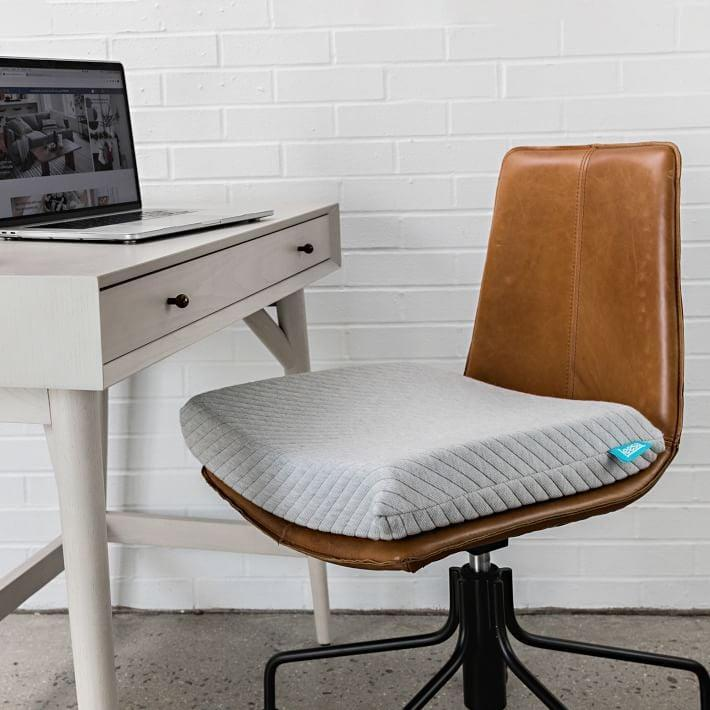 <p>If they've got back pain from their work from home setup, gift them this <span>Leesa Seat Cushion</span> ($79).</p>