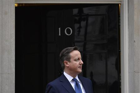 Britain's PM Cameron waits to greet Cyprus's President Anastasiades at Cameron's official residence in Downing Street in central London
