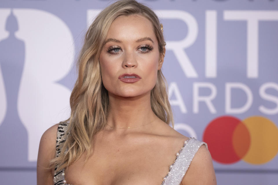 Laura Whitmore poses for photographers upon arrival at Brit Awards 2020 in London, Tuesday, Feb. 18, 2020.(Photo by Vianney Le Caer/Invision/AP)