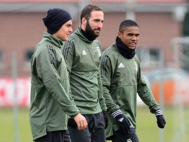 Juventus' Paulo Dybala, Gonzalo Higuain and Douglas Costa during training ahead of the Spurs clash. Reuters