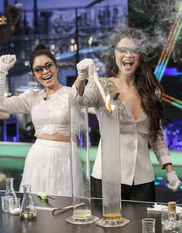 """Selena Gomez and Vanessa Hudgens got goofy with some science experiments when they appeared on Spain's """"El Hormiguero"""" TV show on Friday. But are those appropriate outfits for the ocassion? Where are their lab coats? (3/12013)"""