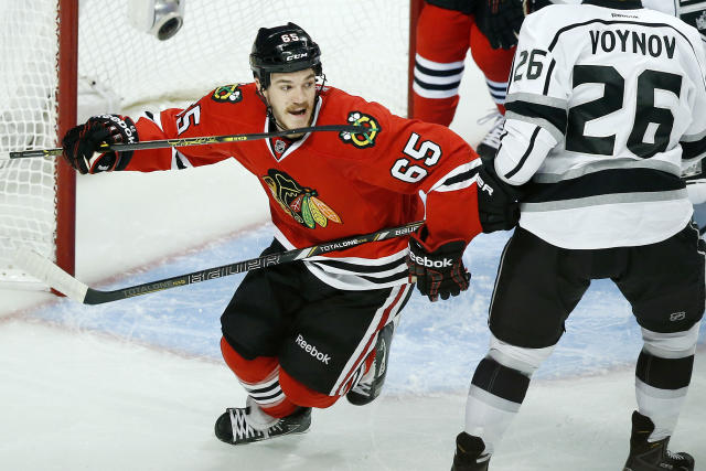 Chicago Blackhawks center Andrew Shaw (65) celebrates after teammate Brent Seabrook scored a goal against the Los Angeles Kings during the first period in Game 5 of the Western Conference finals in the NHL hockey Stanley Cup playoffs on Wednesday, May 28, 2014, in Chicago. The Blackhawks won 5-4 in the second overtime. (AP Photo/Andrew A. Nelles)
