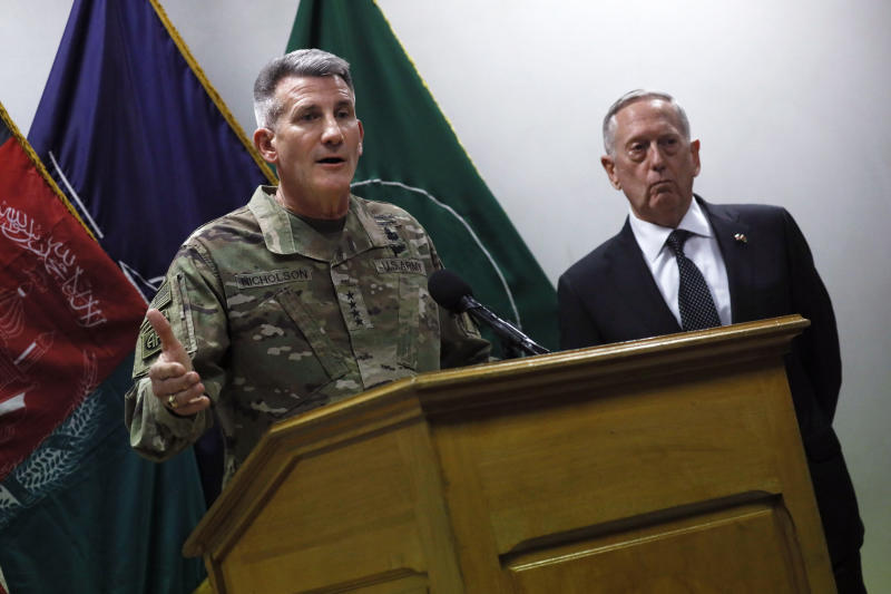 U.S. Defense Secretary James Mattis , right, and U.S. Army General John Nicholson, left, commander of U.S. Forces Afghanistan, hold a news conference at Resolute Support headquarters in Kabul, Afghanistan, Monday, April 24, 2017. Mattis arrived unannounced in Afghanistan to assess America's longest war as the Trump administration weighs sending more U.S. troops. (Jonathan Ernst/Pool Photo via AP)