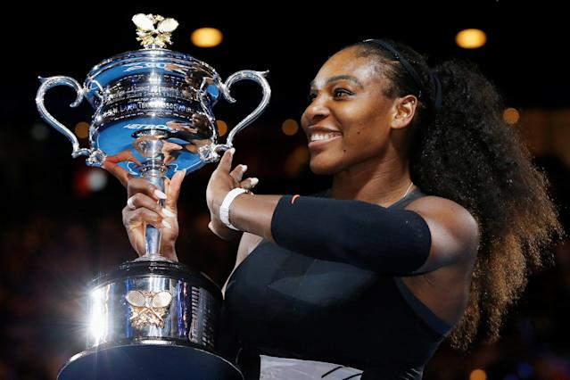FILE PHOTO: Tennis - Australian Open - Melbourne Park, Melbourne, Australia - 28/1/17 Serena Williams of the U.S. holds her trophy after winning her Women's singles final match against Venus Williams of the U.S. .REUTERS/Issei Kato/File photo