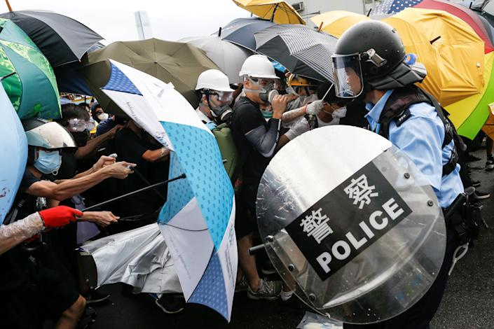 Police try to disperse protesters near a flag raising ceremony for the anniversary of Hong Kong handover to China in Hong Kong, China July 1, 2019. (Photo: Thomas Peter/Reuters)