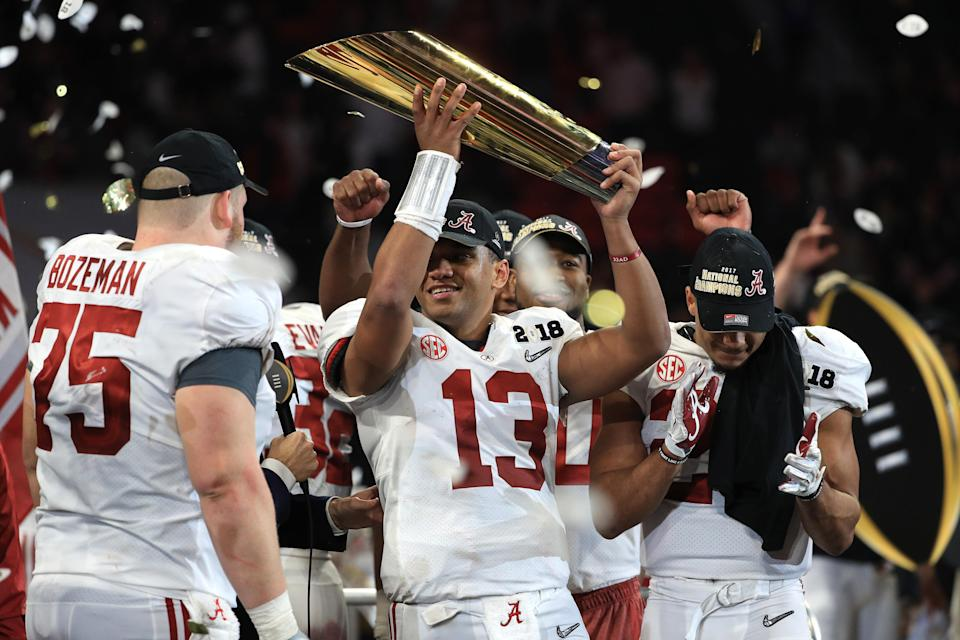 Alabama quarterback Tua Tagovailoa holds up the CFP National Championship trophy at Mercedes-Benz Stadium on January 8, 2018 in Atlanta, Georgia. (Getty)