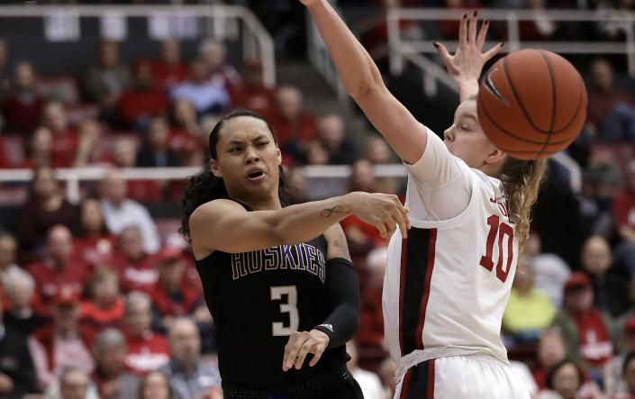 Washington's Mai-Loni Henson, left, passes away from Stanford's Alyssa Jerome (10) during the first half of an NCAA college basketball game Sunday, Jan. 5, 2020, in Stanford, Calif. (AP Photo/Ben Margot)