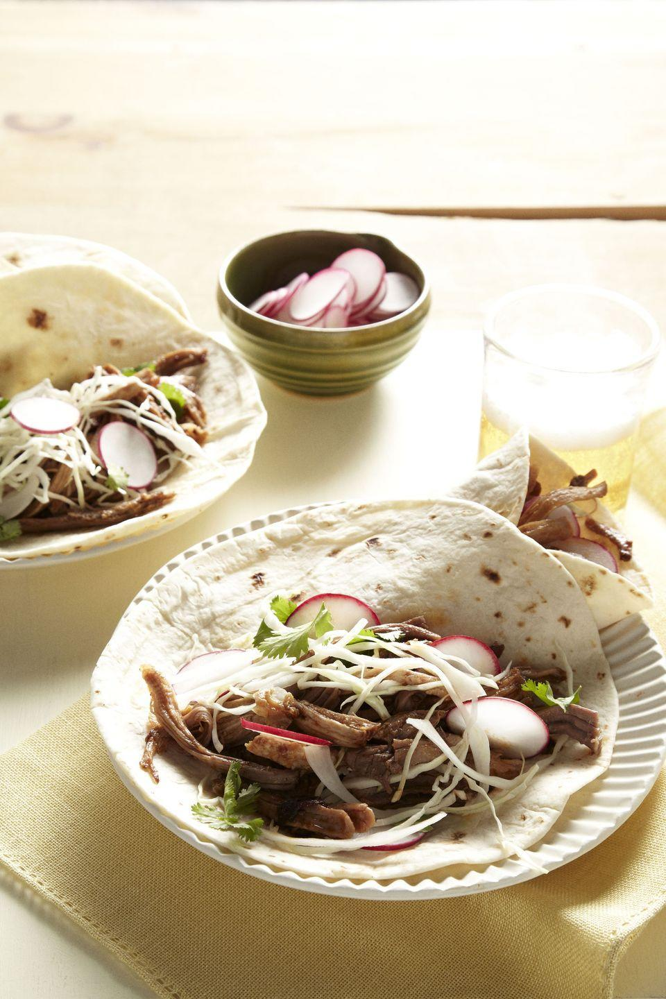 """<p>Prep the meat before work and arrive home to a delicious, ready-to-go taco night.</p><p><em><a href=""""https://www.goodhousekeeping.com/food-recipes/a14795/chipotle-pork-tacos-recipe-ghk0313/"""" rel=""""nofollow noopener"""" target=""""_blank"""" data-ylk=""""slk:Get the recipe for Chipotle Pork Tacos »"""" class=""""link rapid-noclick-resp"""">Get the recipe for Chipotle Pork Tacos »</a></em></p><p><strong>RELATED: </strong><a href=""""https://www.goodhousekeeping.com/food-recipes/g3463/cinco-de-mayo-taco-recipes/"""" rel=""""nofollow noopener"""" target=""""_blank"""" data-ylk=""""slk:20 Easy Recipes for Taco Tuesday"""" class=""""link rapid-noclick-resp"""">20 Easy Recipes for Taco Tuesday</a></p>"""