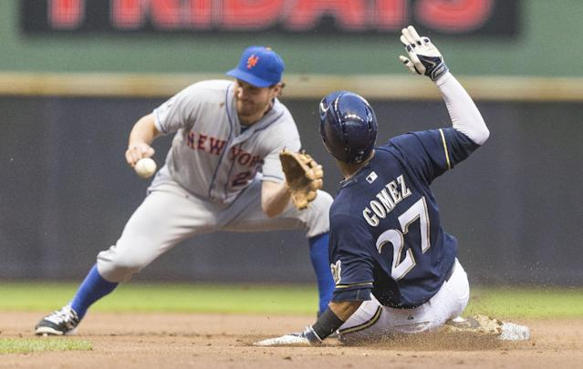 Milwaukee Brewers' Carlos Gomez steals second against New York Mets' as Daniel Murphy covers during the second inning of a baseball game Thursday, July 24, 2014, in Milwaukee. (AP Photo/Tom Lynn)