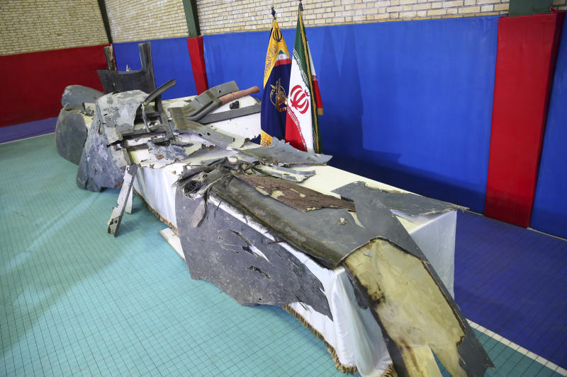FILE - In this Friday, June 21, 2019 file photo, debris from what Iran's Revolutionary Guard aerospace division describes as the U.S. drone which was shot down on Thursday is displayed in Tehran, Iran. A year after President Trump's unilateral withdrawal from the 2015 deal, the U.S. and Iran are already locked in a volatile standoff. Last week, Iran shot down a U.S. military drone, saying it violated Iranian airspace, though Washington said it was above international waters. (Meghdad Madadi/ Tasnim News Agency via AP, file)