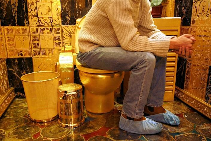 A gold toilet in Hong Kong. The new palace has been the subject of a sometimes farcical dispute in the run-up to the elections between Erdogan and the main opposition leader Kemal Kilicdaroglu, who accused him of having golden toilet seats there (AFP Photo/Mike Clarke)