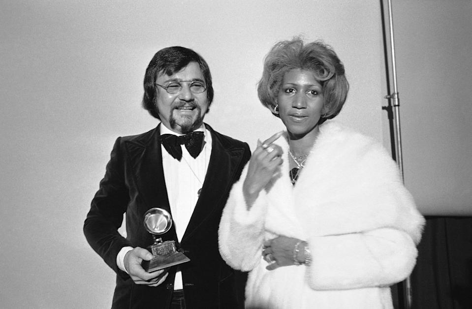 <p>Composer Sylvester Levay and Aretha Franklin, pictured right in a white fur coat, at the Grammy Awards in Los Angeles. (AP Photo) </p>