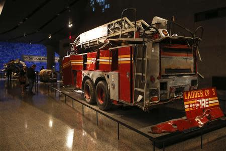 A FDNY fire truck from Ladder Co. 3 is seen inside the National September 11 Memorial & Museum during a press preview in New York May 14, 2014. REUTERS/Shannon Stapleton