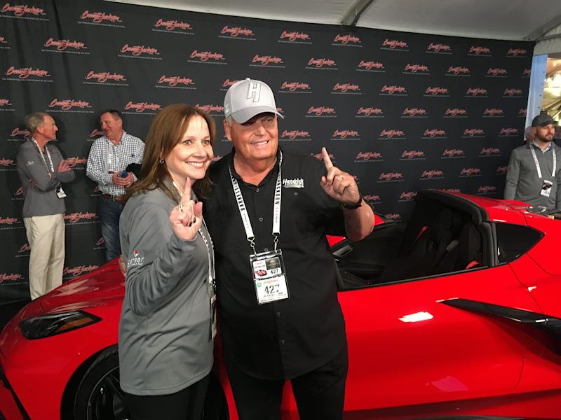 GM CEO Mary Barra and Corvette collector Rick Hendrick at the auction block where Henrdrick paid $3 million for VIN #0001 of the first mid-engine Corvette.