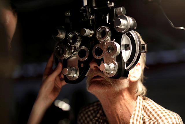 <p>A man receives an eye exam at the Remote Area Medical Clinic in Wise, Va., July 21, 2017. (Photo: Joshua Roberts/Reuters) </p>