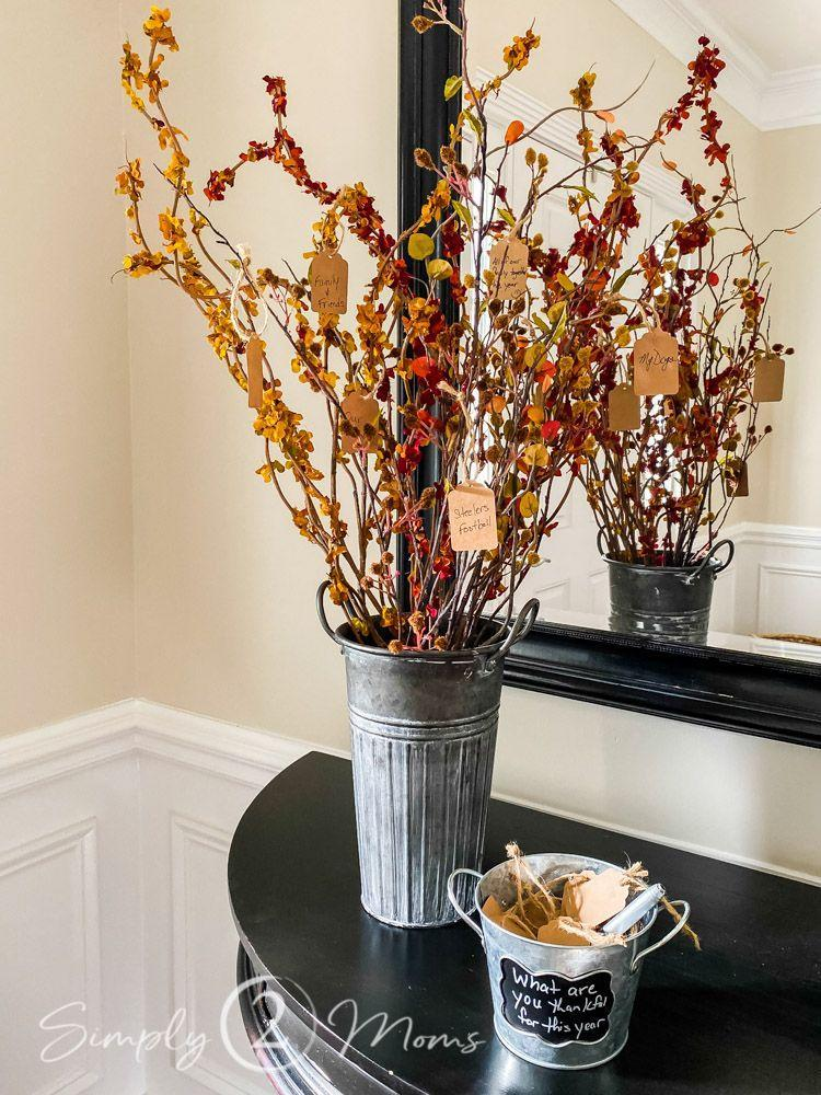 "<p>Arrange beautiful fall stems in a container to add a truly cozy and rustic touch of autumn to any space in your home — then use <a href=""https://www.amazon.com/Paper-Wrapping-Shipping-Covering-Recycled/dp/B0788YRV9V?tag=syn-yahoo-20&ascsubtag=%5Bartid%7C10055.g.33525114%5Bsrc%7Cyahoo-us"" rel=""nofollow noopener"" target=""_blank"" data-ylk=""slk:kraft paper"" class=""link rapid-noclick-resp"">kraft paper</a>, a paper punch and some twine to create the tags. We also love the idea of leaving out a bucket of tags for guests to fill out and attach to the tree themselves!</p><p><em><a href=""https://simply2moms.com/the-thankful-tree/"" rel=""nofollow noopener"" target=""_blank"" data-ylk=""slk:Get the tutorial at Simply 2 Moms »"" class=""link rapid-noclick-resp"">Get the tutorial at Simply 2 Moms »</a></em> </p><p><strong>RELATED: </strong><a href=""https://www.goodhousekeeping.com/home/decorating-ideas/g2716/fall-decorations/"" rel=""nofollow noopener"" target=""_blank"" data-ylk=""slk:35 DIY Fall Decorations That'll Give Your Home a Warm and Cozy Feel"" class=""link rapid-noclick-resp"">35 DIY Fall Decorations That'll Give Your Home a Warm and Cozy Feel</a></p>"