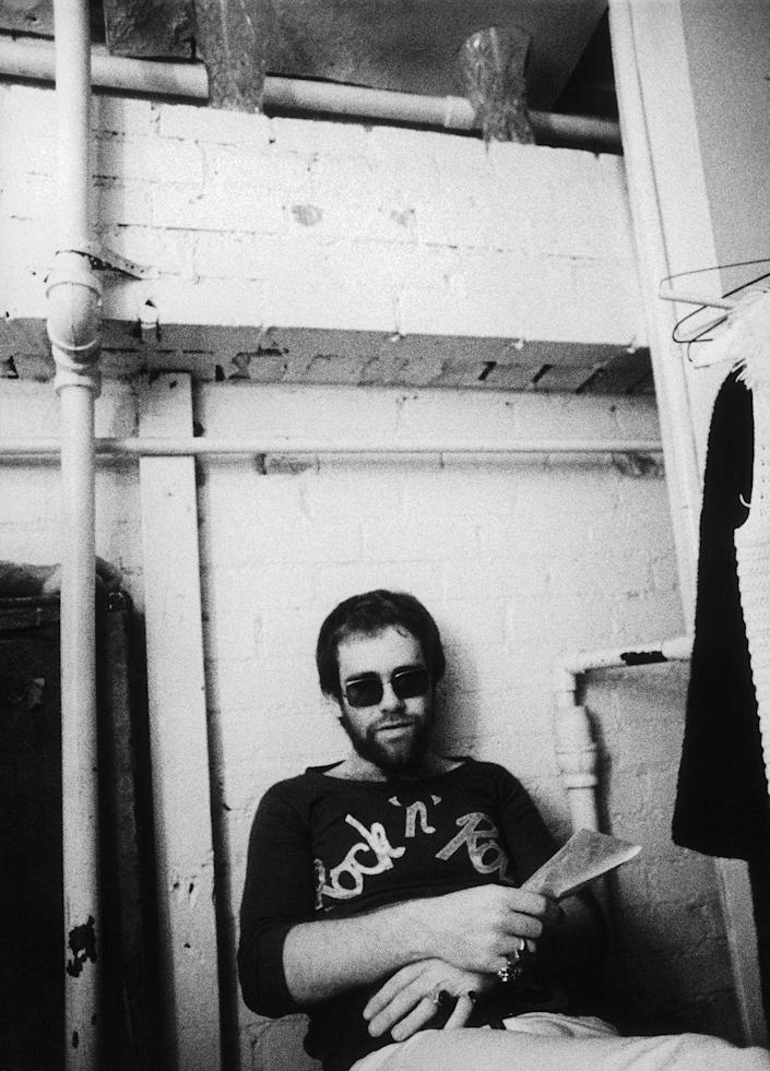 <p>Elton John relaxes backstage at Doug Weston's Troubadour on August 25, 1970 in Los Angeles (now West Hollywood), California.</p>