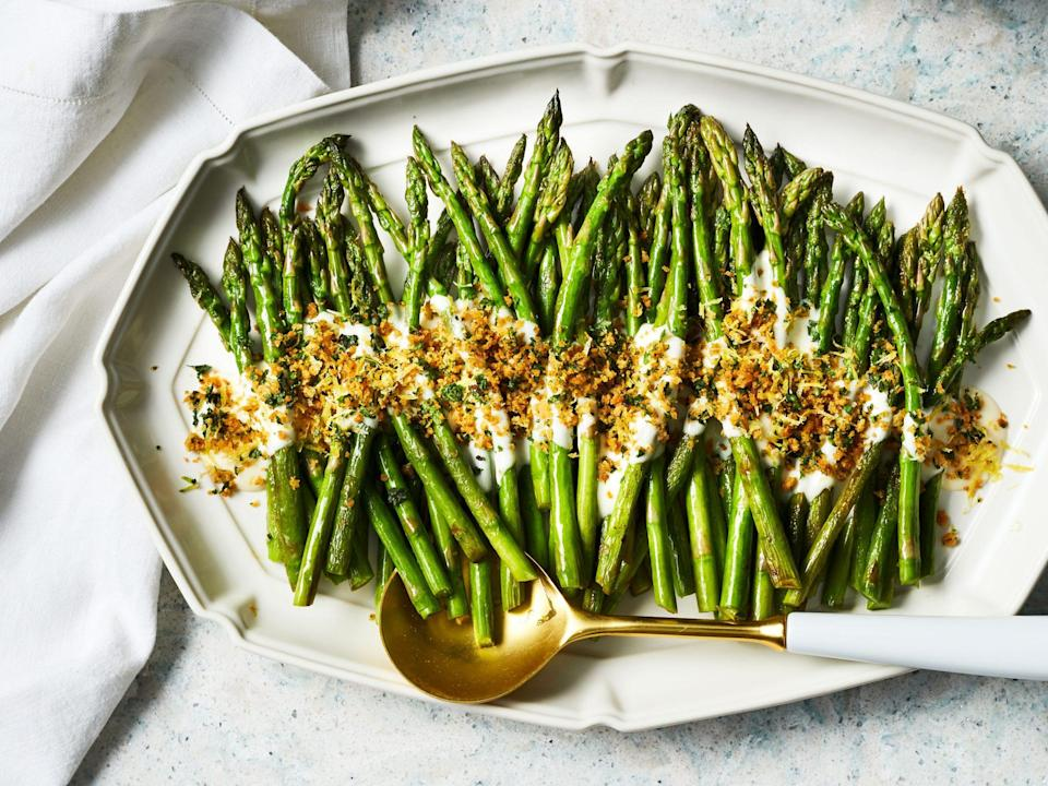 "<p><strong>Recipe: </strong><a href=""https://www.southernliving.com/recipes/asparagus-cheese-sauce-herb-breadcrumbs"" rel=""nofollow noopener"" target=""_blank"" data-ylk=""slk:Asparagus with Cheese Sauce and Herb Breadcrumbs"" class=""link rapid-noclick-resp""><strong>Asparagus with Cheese Sauce and Herb Breadcrumbs</strong></a></p> <p>This fresh recipe is the ultimate spring side dish. Pretty enough for Easter lunch but quick and easy enough for a weeknight meal, this recipe from our April 2020 issue is a keeper. One reader said ""it got rave reviews"" from her family.</p>"