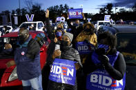 FILE - In this Nov. 2, 2020, file photo, supporters listen as Democratic presidential candidate former Vice President Joe Biden speaks at a drive-in campaign rally at Lexington Technology Park in Pittsburgh. A tough road lies ahead for Biden who will need to chart a path forward to unite a bitterly divided nation and address America's fraught history of racism that manifested this year through the convergence of three national crises. (AP Photo/Andrew Harnik, File)