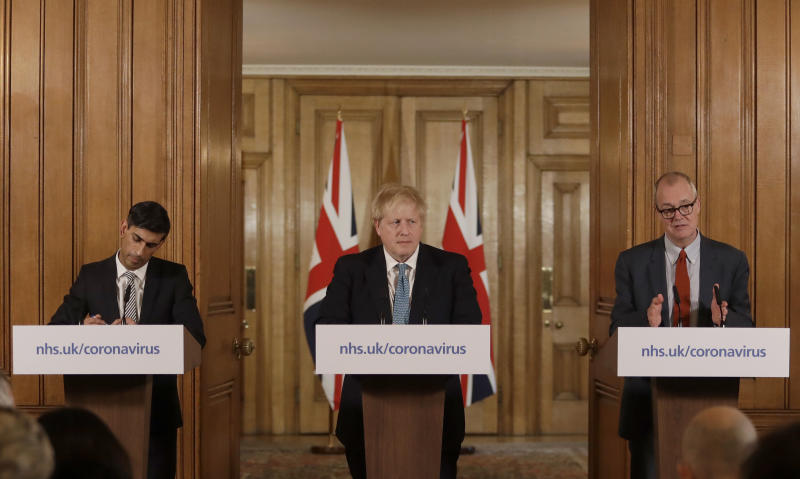 Britain's Chancellor Rishi Sunak, British Prime Minister Boris Johnson and Chief scientific officer Patrick Vallance give a press briefing about the ongoing situation with the COVID-19 coronavirus outbreak, inside 10 Downing Street in London, Tuesday, March 17, 2020. For most people, the new coronavirus causes only mild or moderate symptoms, such as fever and cough. For some, especially older adults and people with existing health problems, it can cause more severe illness, including pneumonia. (AP Photo/Matt Dunham, Pool)