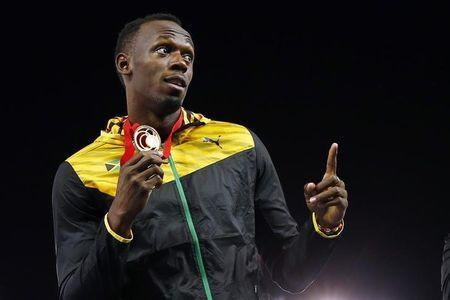 Jamaica's Usain Bolt holds his gold medal after Jamaica won the men's 4x100m relay final at the 2014 Commonwealth Games in Glasgow, Scotland, August 2, 2014. REUTERS/Andrew Winning